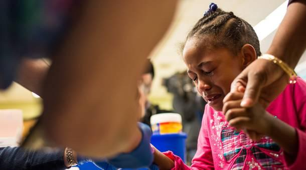 Tears stream down the face of Morgan Walker, age 5 of Flint, as she gets her finger pricked for a lead screening on January 26, 2016 at Eisenhower Elementary School in FlintMichigan.