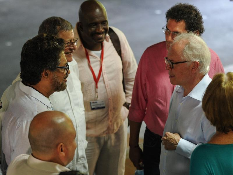 Aronson (on the right in white shirt) speaks with members of the FARC guerrillas during negotiations between the government and the rebels in Havana, Cuba, on Nov. 19, 2015.