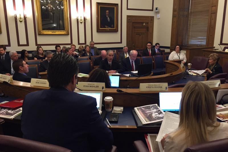 Indiana University CFO John Seidinaj and VP John Applegate present to the State Budget Committee. (Brandon Smith/IPB News)