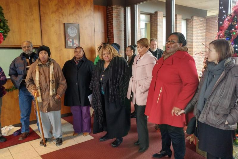 Community organizers and East Chicago residents talk to reporters after a closed meeting with city officials to discuss the status of the city's lead contamination crisis. (Annie Ropeik/IPB News)