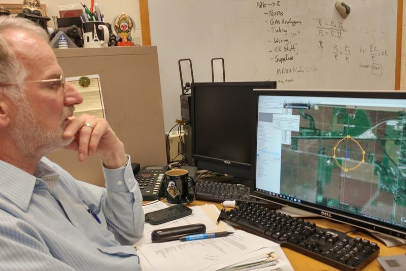 Purdue University agricultural engineer Al Heber plots a hypothetical CAFO setback using a computer model he created. (Annie Ropeik/IPB News)