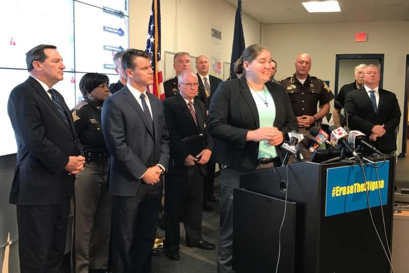 Lebanon, Ind. police officer Taylor Nielsen discusses her struggle with mental health issues while Senator Joe Donnelly (D-Indiana), at far left, and Senator Todd Young (R-Indiana), right of Donnelly, listen. (Brandon Smith/IPB News)