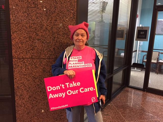 A Planned Parenthood supporter poses with her sign after the U.S. House of Representatives passed the American Health Care Act on Thursday. (Jill Sheridan/IPB News)