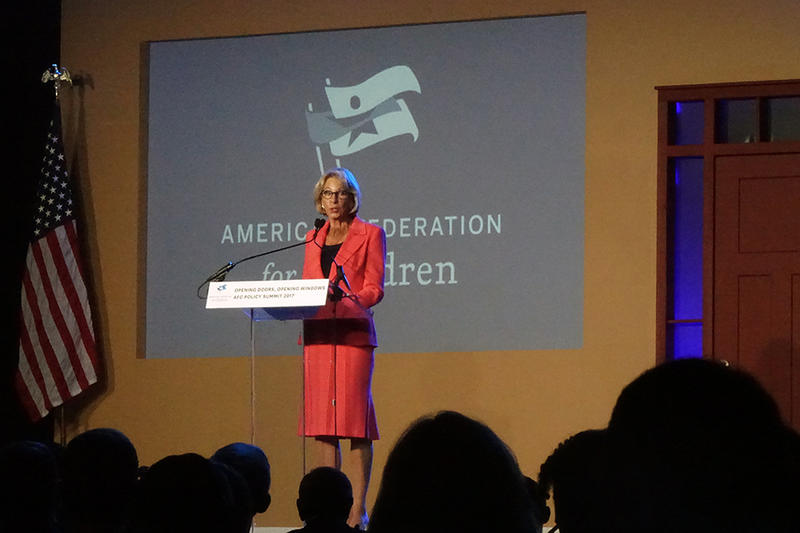 "Secretary of Education Betsy DeVos praises Indiana's choice laws at an event in Indianapolis Monday. She alluded to a forthcoming federal choice program, calling it ""expansive."" (Eliot Cremin/IPB News)"