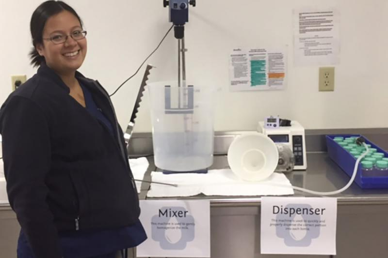 Production director Jami Marvin shows off new equipment at the bank. (Jill Sheridan/IPB News)