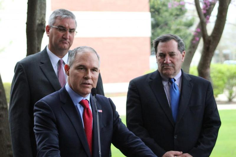 U.S. EPA Administrator Scott Pruitt reads a statement to reporters during a visit to East Chicago in April, alongside state and local officials including Gov. Eric Holcomb and U.S. Sen. Joe Donnelly. (Nick Janzen/IPB News)