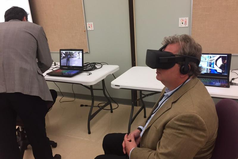 State Sen. Brandt Hershman, R-Buck Creek, tries on an Oculus Rift virtual reality headset at Hope Academy in Indianapolis on Thursday, Aug. 10, 2017. (Eric Weddle/WFYI News)