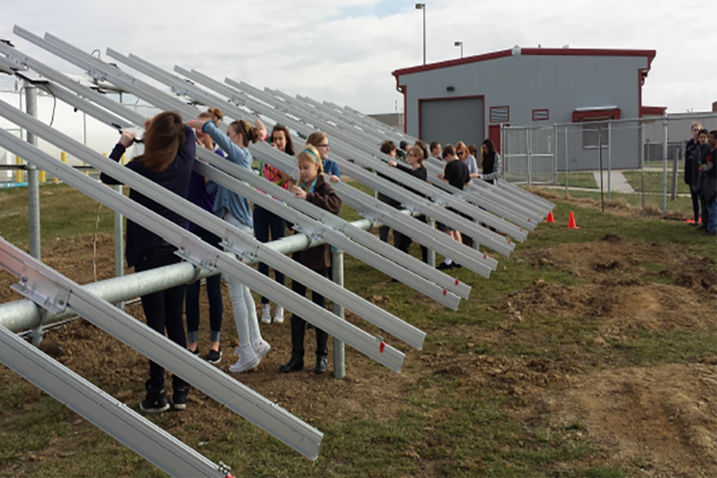 Students build racking for 950 solar panels at the Lake Prairie Elementary School array. (Credit: Tri-Creek School Corporation)