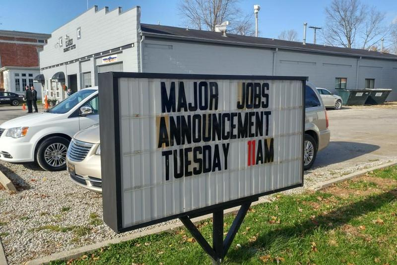 A sign heralded a new employer's arrival in the small Carroll County town of Camden last fall. (Annie Ropeik/IPB file photo)