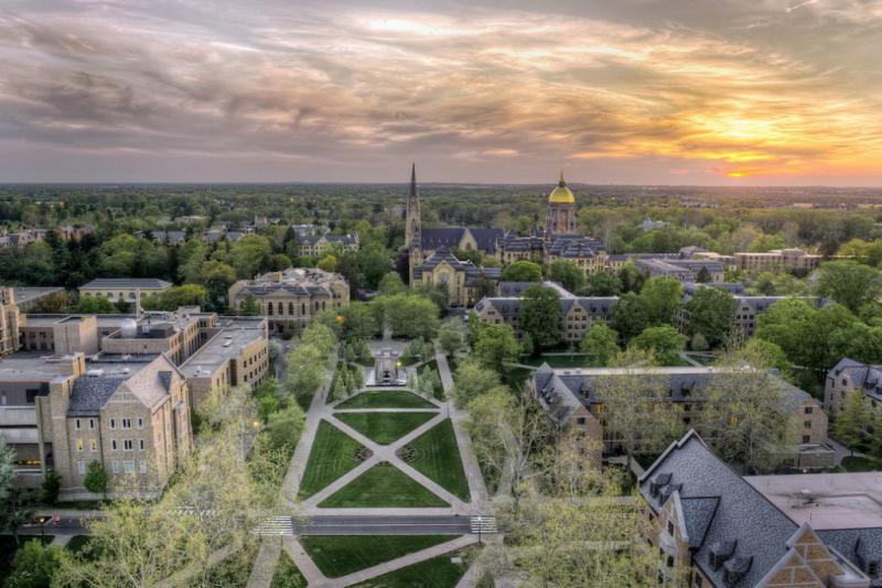 """The University of Notre Dame ranked No. 18 in U.S. News and World Report's 2018 """"Best Colleges"""" list released Tuesday. Here the Basilica of the Sacred Heart and Golden Dome at sunset in 2013. (Credit: Barbara Johnston/University of Notre Dame)"""