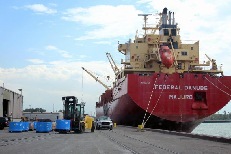 A cargo ship offloads at Burns Harbor in August. (Annie Ropeik/IPB News)