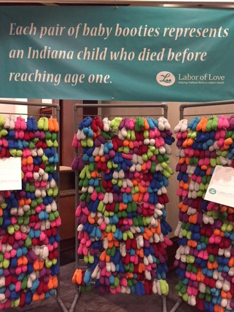 A display at the Indiana Labor of Love summit, each pair of booties represents a Hoosier child who died before their first birthday. (IPB News/Jill Sheridan)