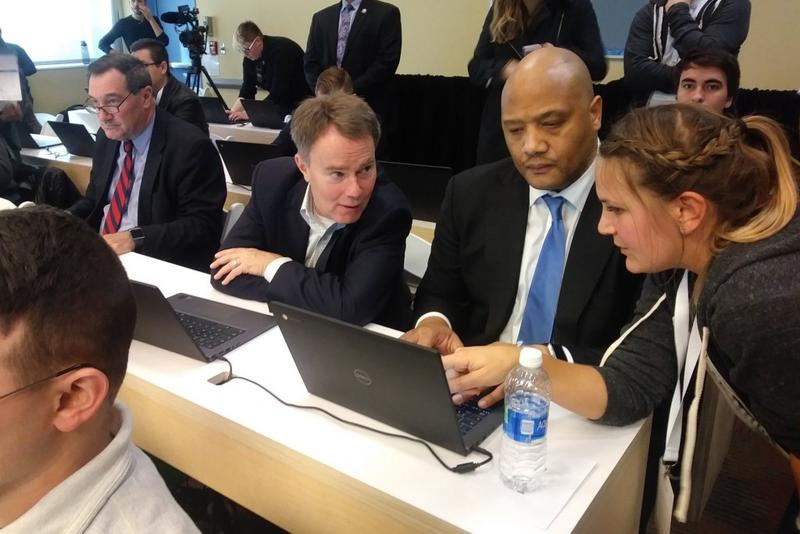 U.S. Rep. Andre Carson (D-Ind.) and Indianapolis Mayor Joe Hogsett receive help during a coding class. (Lauren Chapman/IPB News)
