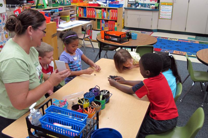 Students at a pre-kindergarten camp in Avon, Indiana, play a counting game. (FILE PHOTO: Elle Moxley/StateImpact Indiana)