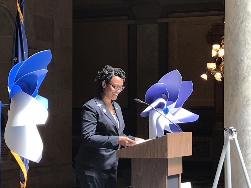 DCS Director Terry Stigdon addresses a crowd of child advocates at the Statehouse celebration of National Child Abuse Prevention Month. (Brandon Smith/IPB News)
