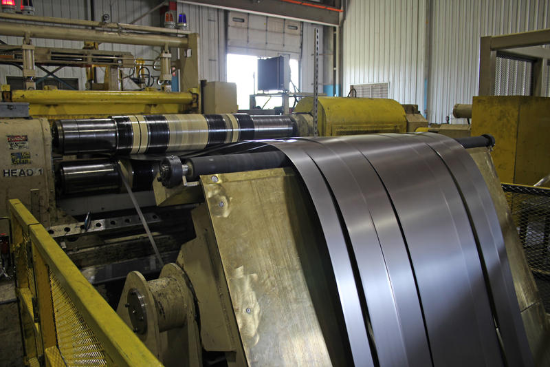 A steel coil is rolled out and slit to various widths for different customers at Mill Steel. (FILE PHOTO: Annie Ropeik/IPB News)