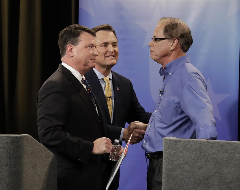 Indiana's Republican U.S. Senate candidates (from left) Rep. Todd Rokita (R-Brownsburg), Rep. Luke Messer (R-Greensburg), and Mike Braun greet each other after the final debate before the May primary election. (Darron Cummings/Indiana Debate Commission)