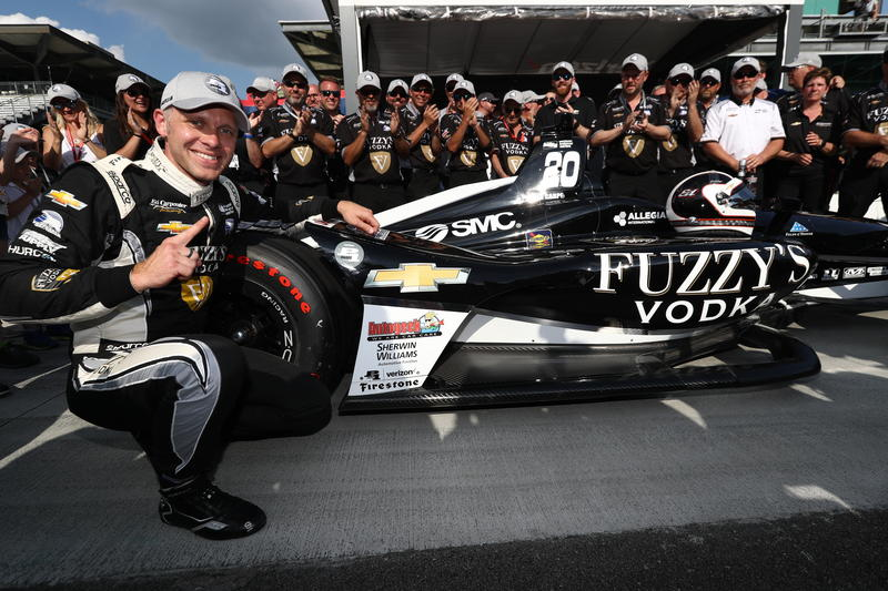 Ed Carpenter with the Verizon P1 Award emblem after winning the pole position for the 102nd Indianapolis 500 at the Indianapolis Motor Speedway. (Photo courtesy of Chris Jones/Indianapolis Motor Speedway)