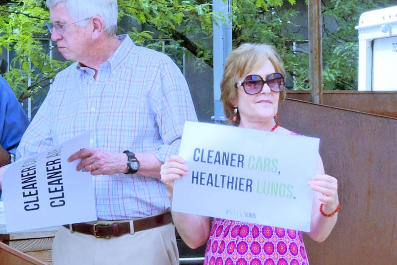 At a press conference environmentalists and others opposed the EPA's plans to roll back clean car standards (Rebecca Thiele/IPB News)