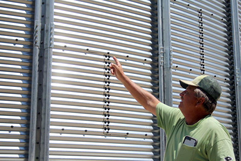 Mike Morehouse, a fifth generation farmer in Elkhart, Indiana, points to his new grain bin. (Samantha Horton/IPB News)