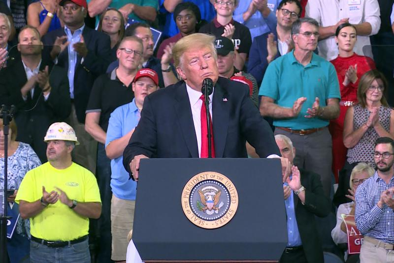 President Donald Trump speaks to the crowd in Evansville where he endorsed Republican Senate candidate Mike Braun. (Alex Eady/WTIU)
