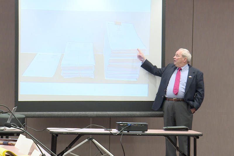 Indiana State Police Forensic Analysis Director Eric Lawrence demonstrates how much case files have grown because of recent changes to how drug crimes are prosecuted. (Lauren Chapman/IPB News)