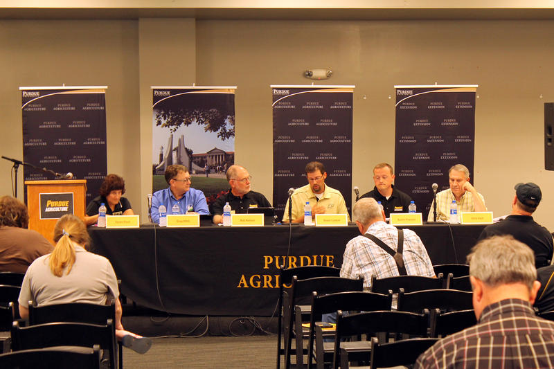 Panelists from Purdue University and the USDA discuss this year's crop and the economic impact of that supply. (Lauren Chapman/IPB News)