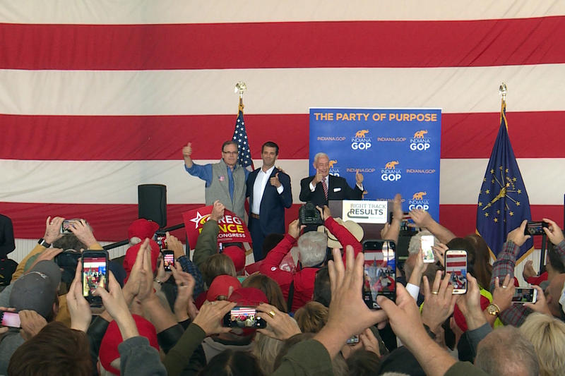 Donald Trump Jr., center, rallies in Greenfield, Indiana, with Republican Senate candidate Mike Braun, left, and 6th Congressional District candidate Greg Pence, right. (Lauren Chapman/IPB News)