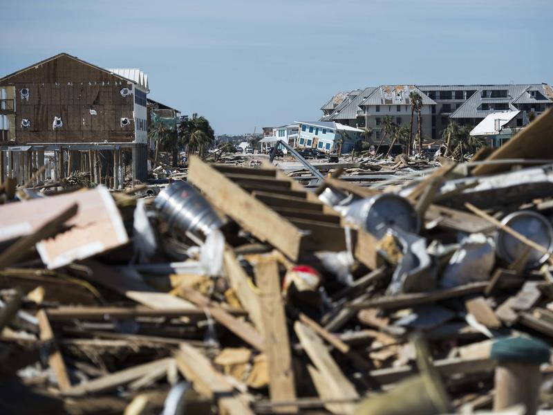 Destroyed homes and debris are seen near Port St. Joe, Fla., on Friday, two days after Hurricane Michael hit the Florida panhandle. Analysts estimate the storm has caused billions of dollars of damage.