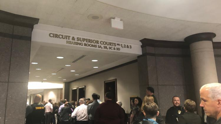 A line of people gathers outside the Hamilton County courtroom for the hearing of the suspect accused of shooting his teacher and classmate at Noblesville West Middle School.