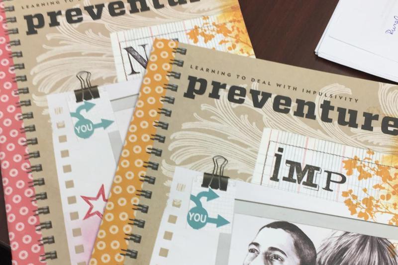 The workbooks used through the Preventure program. (Jill Sheridan/IPB News)