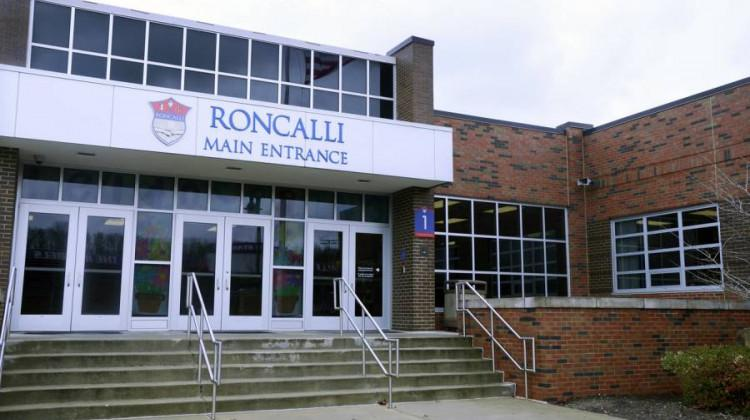 Shelly Fitzgerald, a Roncalli High School guidance counselor placed on paid administrative leave after her marriage to a woman became public, has filed a discrimination claim against the school and the Archdiocese of Indianapolis.