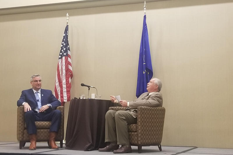 Gov. Eric Holcomb answers Indiana Farm Bureau President Randy Kron's questions about issues impacting the Hoosier agriculture industry. (Samantha Horton/IPB News)