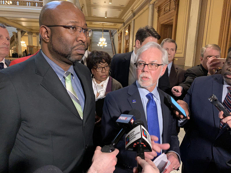 Sen. Greg Taylor (D-Indianapolis) and Sen. Tim Lanane (D-Anderson) discuss a change made to the hate crimes bill. (Brandon Smith/IPB News)