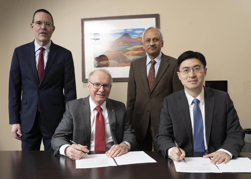Leaders from Indiana University School of Medicine and Purdue University's College of Engineering sign a memorandum of understanding to formalize the partnership. (Photo provided by Purdue University)