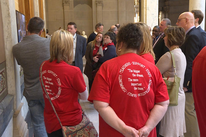 Teachers dressed in red joined other education advocates at a school funding meeting in the statehouse. (Jeanie Lindsay/IPB News)
