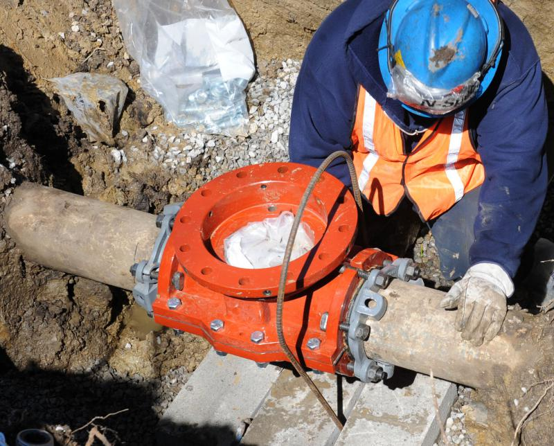 Workers replace a water main valve at Scott Air Force Base in Illinois, 2011. Indiana American Water plans to replace more than 30 miles of water mains in Indiana (U.S. Air Force)