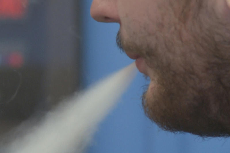Exhaling smoke from an e-cigarette. (WFIU/WTIU)