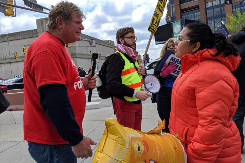 Trump supporters hung around the protesters. While there was some yelling, most of their interactions were cordial. (Drew Daudelin/WFYI News)