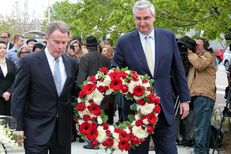 Indianapolis Mayor Joe Hogsett and Gov. Eric Holcomb lay a wreath at Richard Lugar Plaza in Indianapolis. (Lauren Chapman/IPB News)