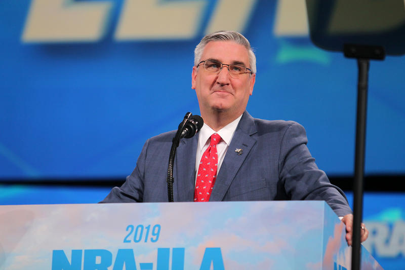 Gov. Eric Holcomb was joined by state lawmakers to sign a firearms matters bill into law. The bill extends Stand Your Ground law protections to civil court and eliminates fees for short, five-year handgun licenses. (Lauren Chapman/IPB News)