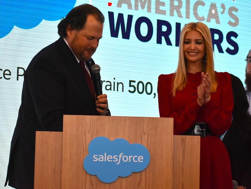 "Salesforce Chairman Marc Benioff signs President Trump's ""Pledge to America's Workers"" alongside Ivanka Trump. (Justin Hicks/IPB News)"