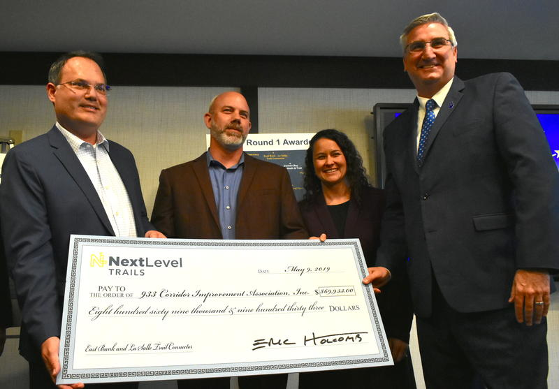 Gov. Eric Holcomb presented a check to the 933 Corridor Improvement Association as part of the Next Level Trails initiative. (Justin Hicks/IPB News)