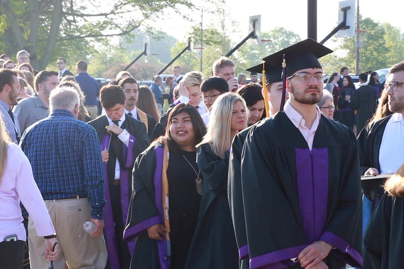 Taylor University graduates line up before filing into their graduation ceremony. A few dozen walked out before Vice President Mike Pence spoke. (Aric Harvig/IPB News)