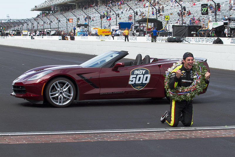 Simon Pagenaud celebrates at the yard of bricks after winning the Indianapolis 500 on Sunday, May 26, 2019. (Doug Jaggers/WFYI)
