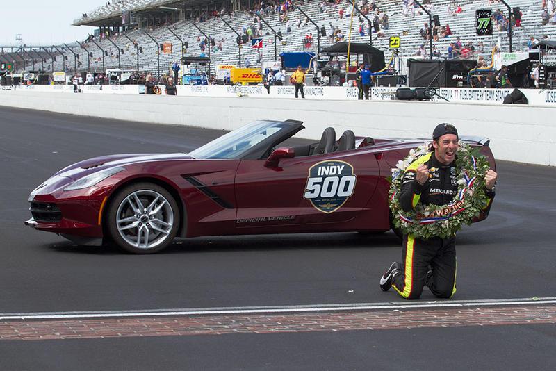 Simon Pagenaud celebrates at the yard of bricks after winning the Indianapolis 500. (Doug Jaggers/WFYI)