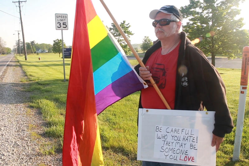 Fite says he spent most of the morning by himself, before a few other protesters joined him. He's protesting Pence because of the vice president's stance on LGBTQ+ rights. (Aric Harvig/IPB News)
