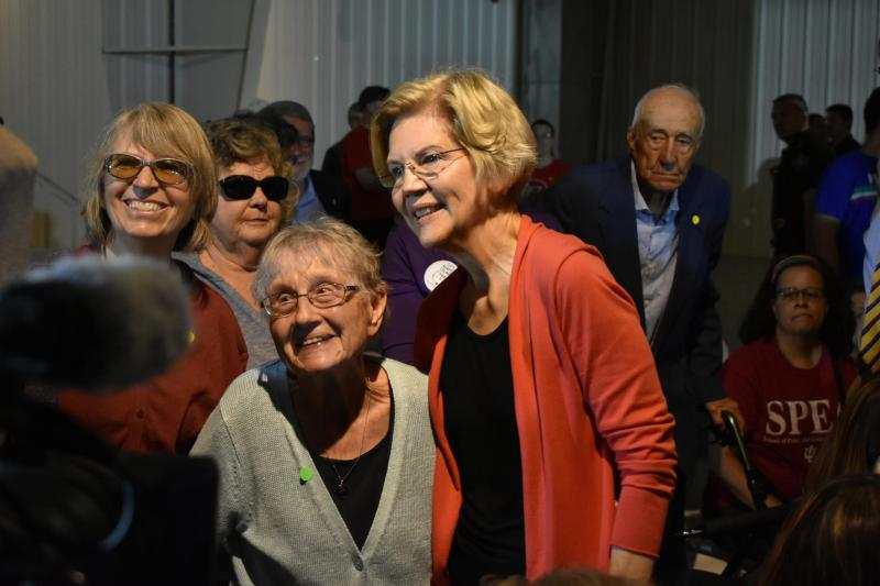 Warren poses for photos with supporters following her rally at the RV Hall of Fame. (Justin Hicks/IPB News)