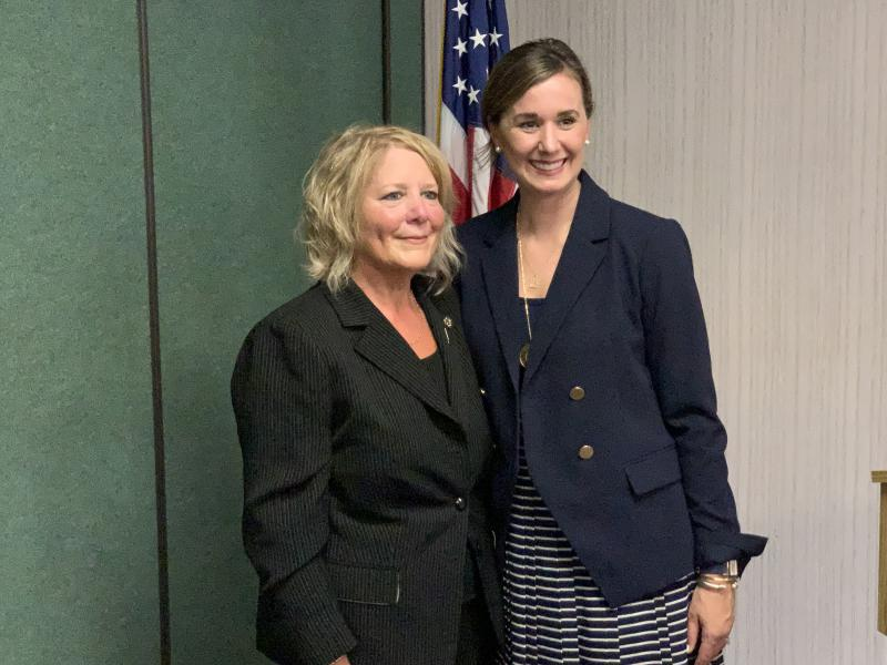 New state representative Dollyne Sherman, left, poses for a photo with Johnson County GOP Chair Beth Boyce after winning a precinct caucus. (Brandon Smith/IPB News)