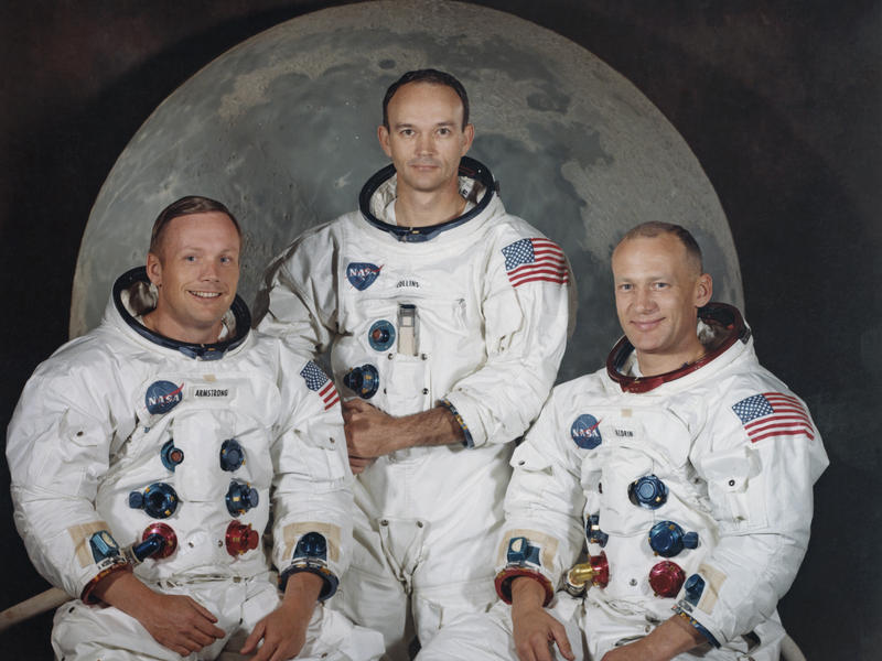 """Michael Collins, center, poses with Neil Armstrong, left, and Edwin """"Buzz"""" Aldrin Jr. for a group portrait a few weeks before they took off to the moon in the Apollo 11 mission in 1969."""